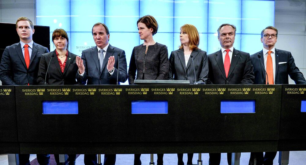 Prime Minister Stefan Lofven gestures next to  leaders of Swedish political parties during a news conference at the Swedish Parliament in Stockholm