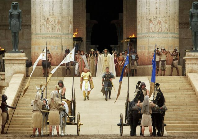 Joel Edgerton, center left, as Ramses, and Christian Bale, center right, as Moses, in a scene from the film, Exodus: Gods and Kings.