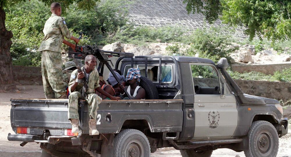 Somalia security forces transport blind-folded suspects detained on their pick-up truck after attackers from the militant group al Shabaab invaded the African Union's Halane base on the edge of the Mogadishu international airport compound in Somalia's capital Mogadishu