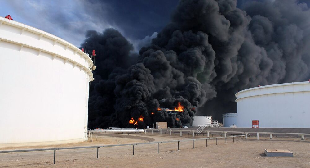 Smoke rises from an oil tank fire in Es Sider port