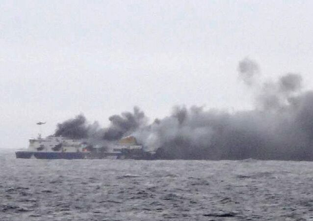 Smoke rises from the Italian-flagged Norman Atlantic after it caught fire in the Adriatic Sea