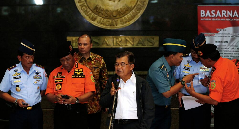 Indonesia's vice-president Jusuf Kalla (C) speaks to the media regarding AirAsia Flight QZ8501 during a visit to the National Search and Rescue Agency in Jakarta December 28, 2014.
