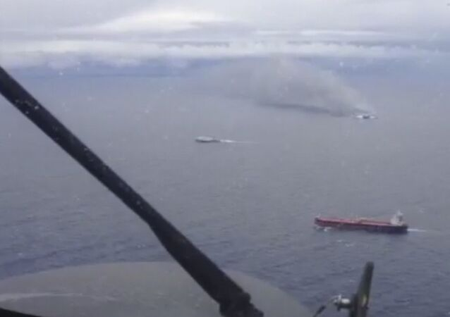 In this image taken from a video released by the Italian Air Force, smoke billows from the Italian-flagged Norman Atlantic, top right, after it caught fire in the Adriatic Sea, Sunday, Dec. 28, 2014.