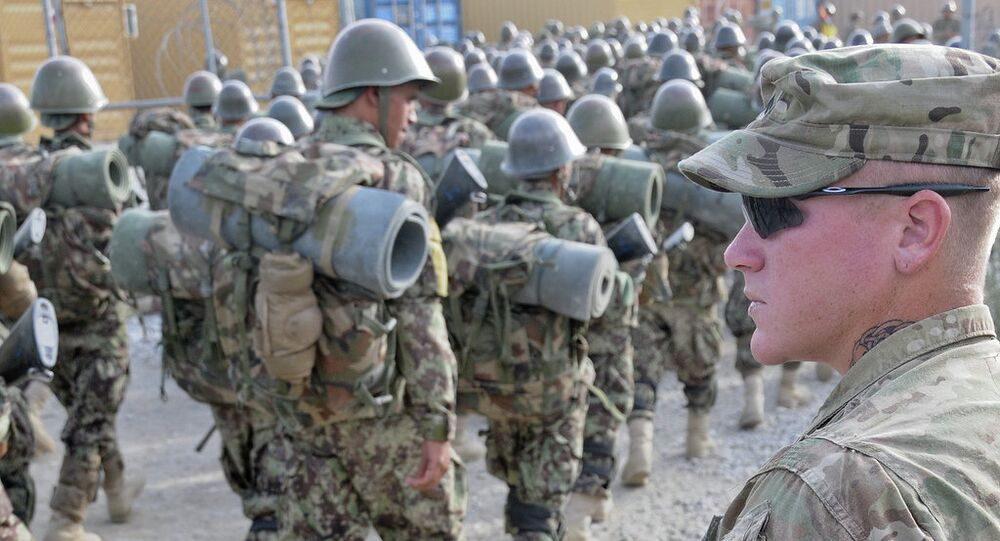 U.S. Army Cpl. William Metz, a Clearwater, Fla., native, now a team leader and adviser with 3rd Battalion, 4th Infantry Regiment, 170th Infantry Brigade Combat Team, watches as Afghan National Army recruits finish a march at the Kabul Military Training Center