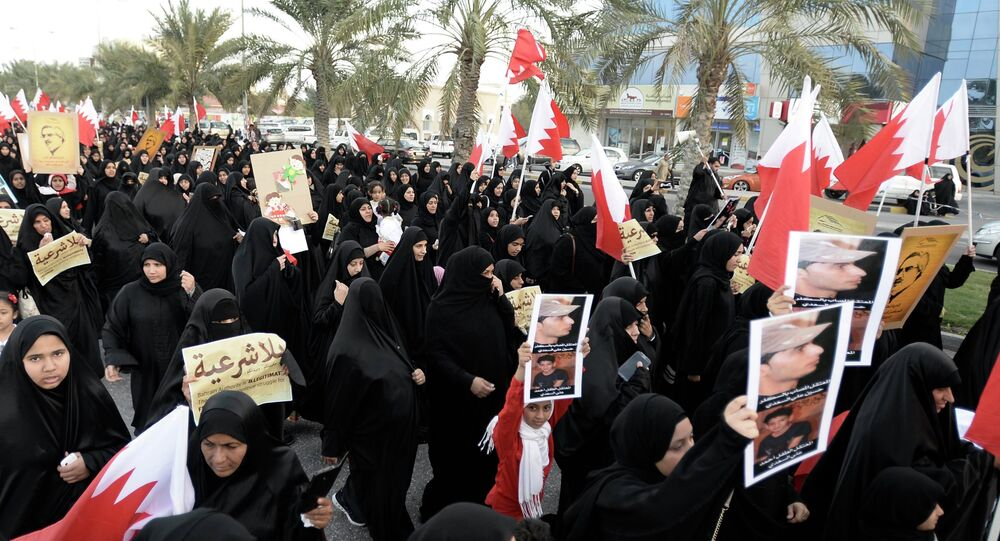 Protesters holding pictures of Al Waad President Ebrahim Shareef march during an anti-government rally organised by Bahrain's main opposition party, Al Wefaq in Budaiya west of Manama, December 26, 2014