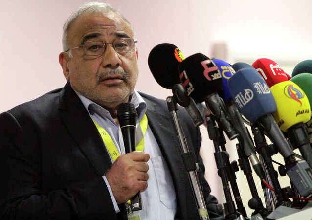 Oil Minister Adel Abdel Mehdi speaks during a news conference at Rumaila oilfield in Basra, southeast of Baghdad December 17, 2014