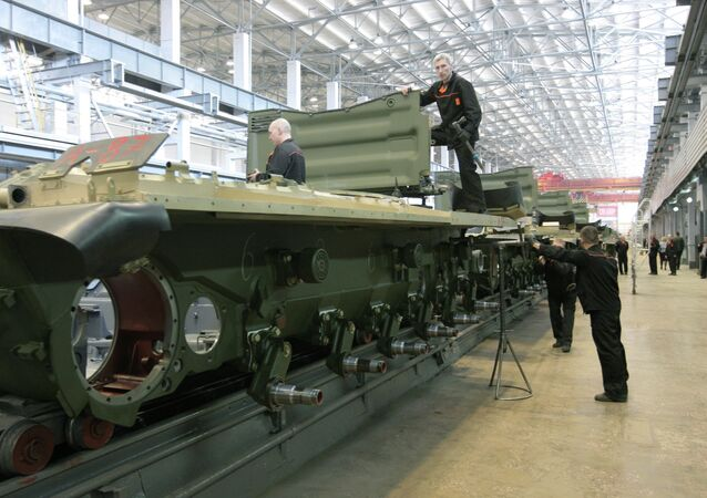 Workers of the JSC Uralvagonzavod assemble tanks on the production floor