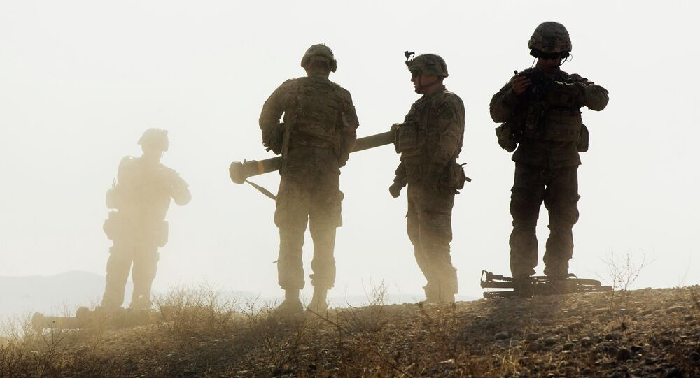 U.S. soldiers walk on a hill after finishing with a training exercise near forward operating base Gamberi in the Laghman province of Afghanistan December 30, 2014