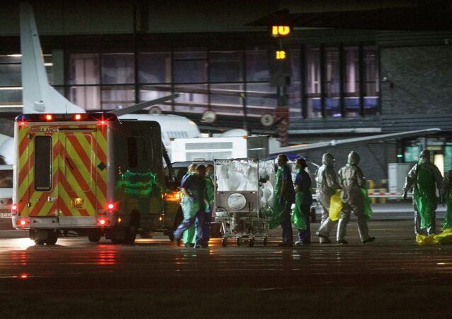 An Ebola patient is transferred on to a Hercules transport plane at Glasgow Airport in Scotland December 30, 2014, to be transported to London