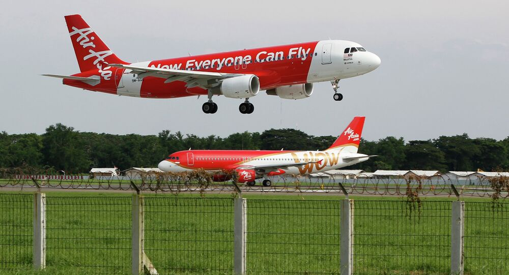 An AirAsia Airbus A320 passenger jet lands at Sukarno-Hatta airport in Tangerang on the outskirts of Jakarta in this January 30, 2013 file picture