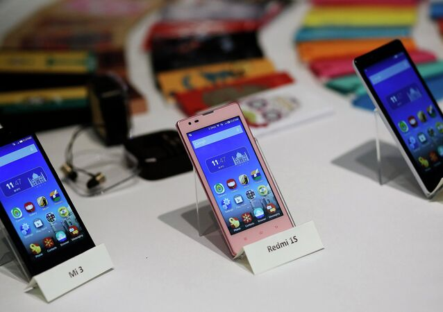 Three models of China's Xiaomi Mi phones are pictured during their launch in New Delhi in this July 15, 2014 file photo
