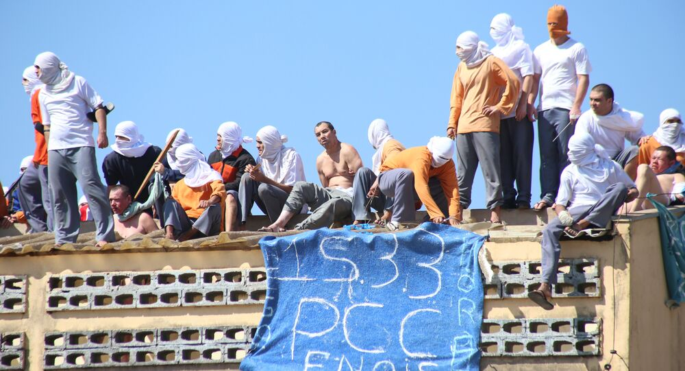 Inmates stand on the roof of the penitentiary in Cascavel, Parana state, Brazil