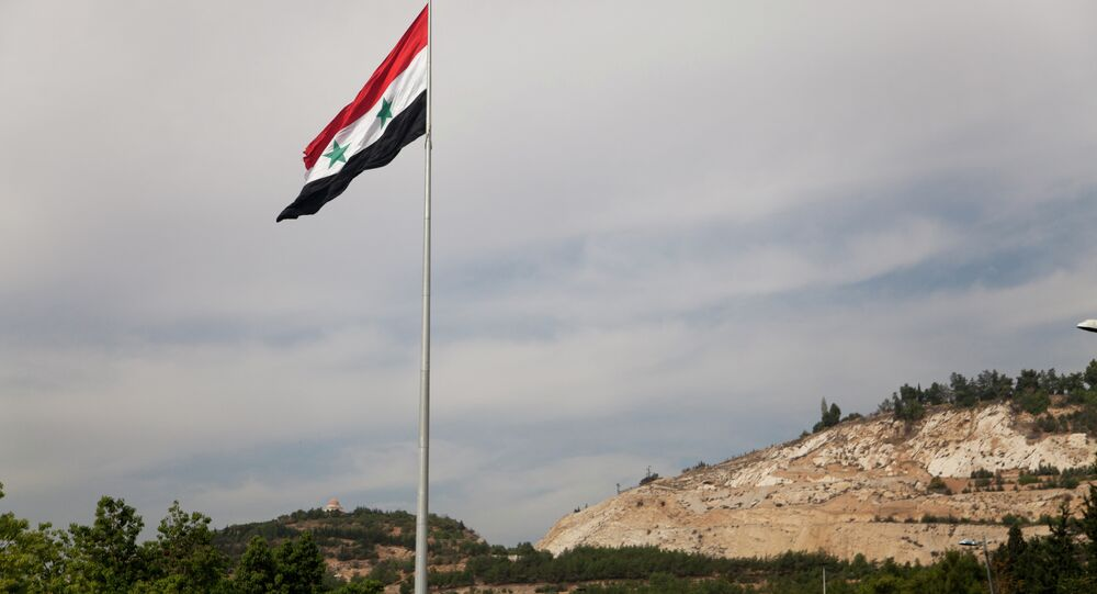 Syrian flag over the capital, Damascus, Syria