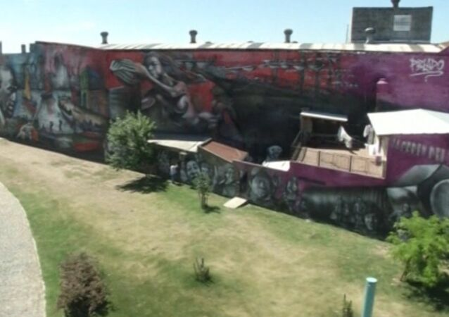 Giant Graffiti With Portraits Presented at Buenos Aires
