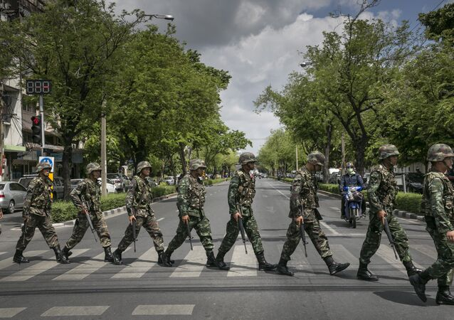 Thai soldiers patrol near government buildings on May 23, 2014 in Bangkok, Thailand