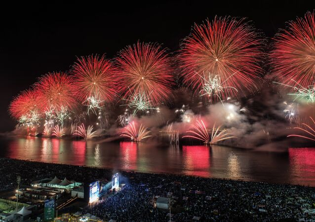 Fireworks for the new year's celebration launch from the boats at Copacabana beach in Rio de Janeiro, Brazil, on January 1, 2014