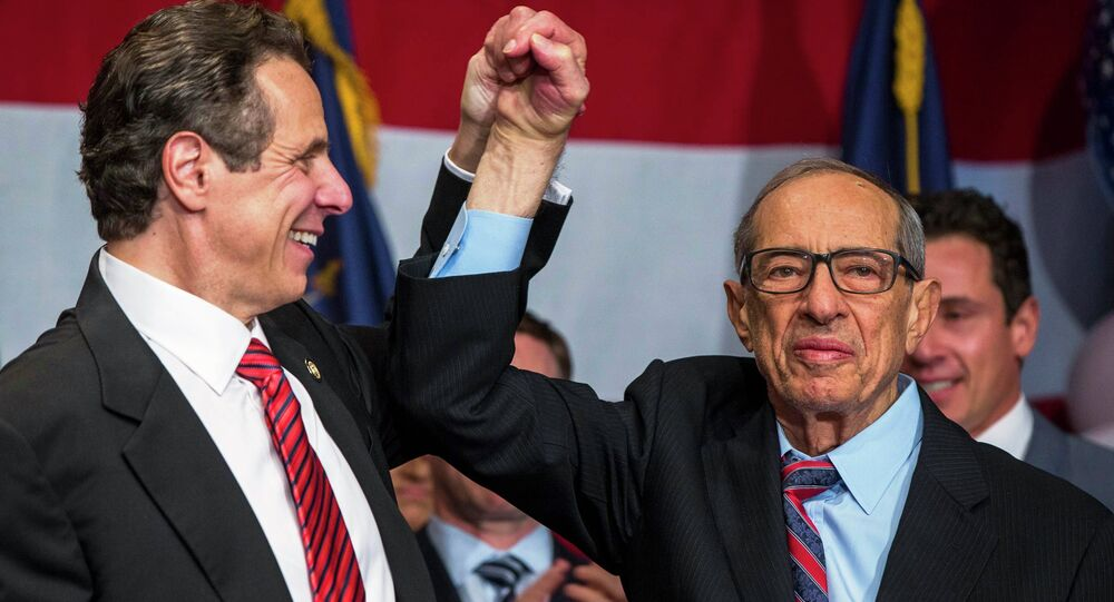 Democratic Governor Andrew Cuomo reacts with his father Mario (R) after being re-elected for the U.S. midterm race in New York