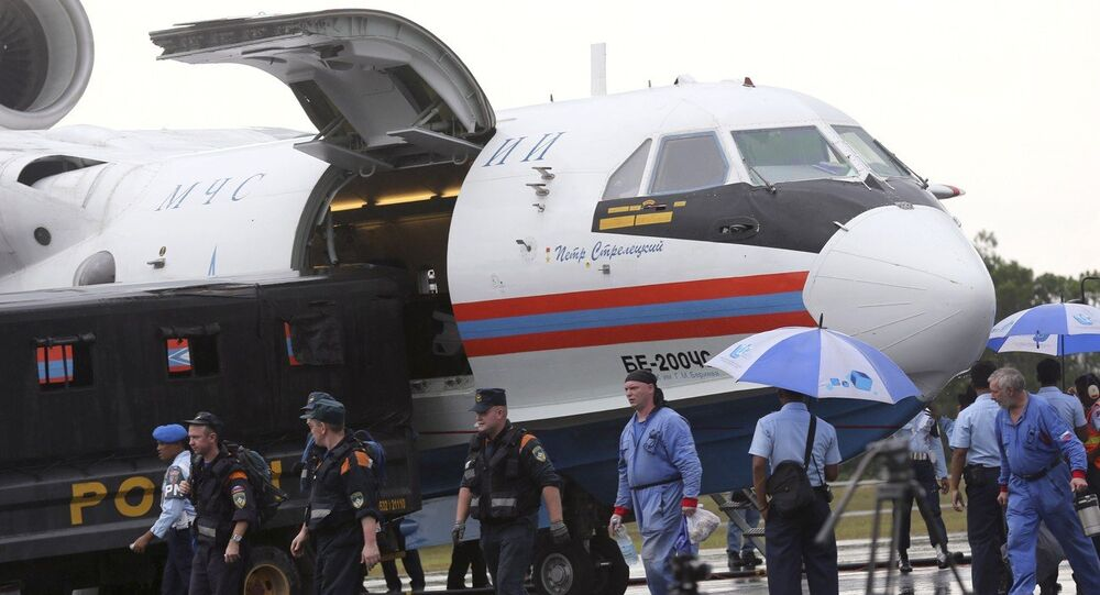 Russian rescuers unload gears from their Beriev Be-200 amphibious aircraft upon arrival to reinforce a search operation for the victims and the wreckage of AirAsia Flight 8501 at Pangkalan Bun Airport, Indonesia