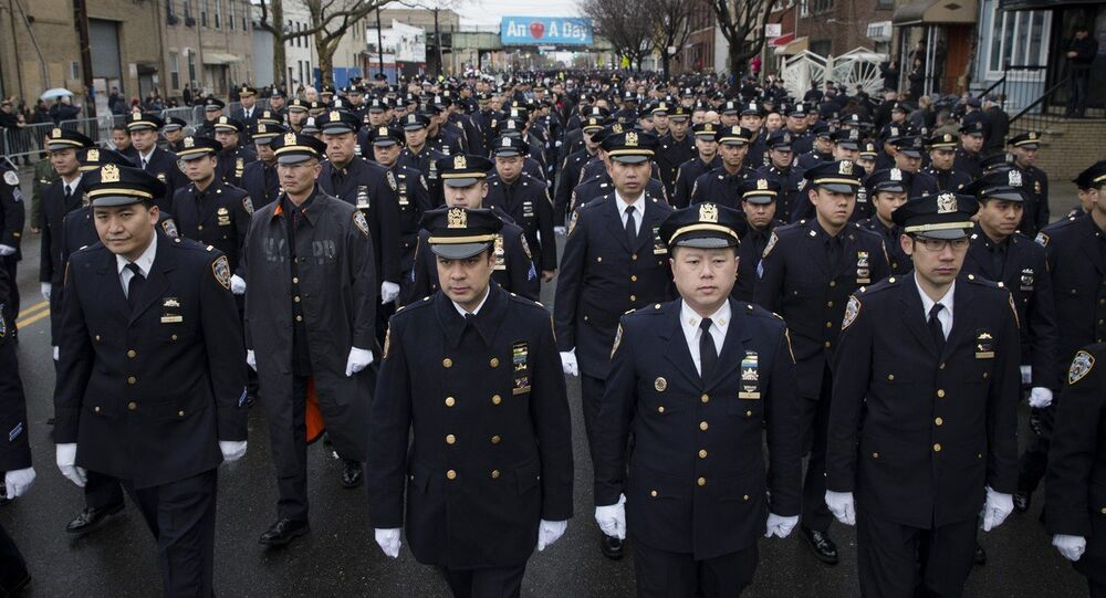 Police officers arrive to the funeral of New York Police Department Officer Wenjian Liu at Aievoli Funeral Home in the Brooklyn borough of New York