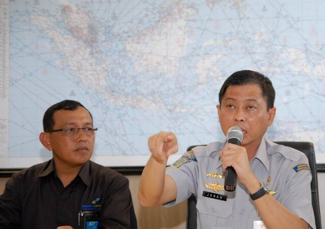 Transportation Minister of Indonesia Ignasius Jonan(R) speaks at a press conference for Air Asia missing flight QZ8501