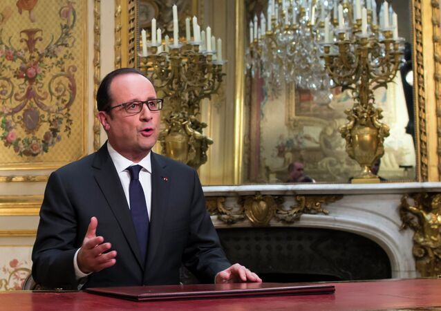 French President Francois Hollande, poses after addressing his New Year's wishes to the nation during a pre-recorded broadcast speech at the Elysee Palace, in Paris