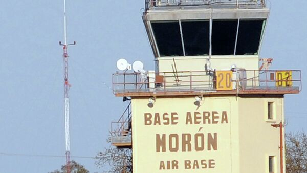 Firefighters stand in front of an air traffic control tower at the Moron de la Frontera air base near Sevilla - Sputnik International
