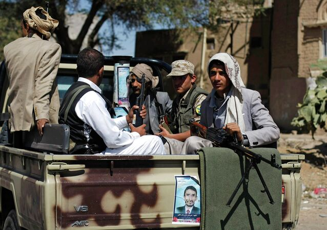 Houthi Shiite rebels ride on a military truck while patrolling a street in Sanaa, Yemen