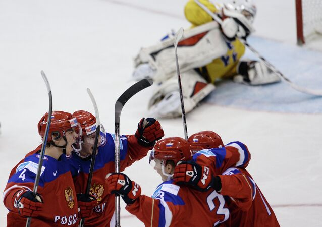 Russian players celebrate their victory in the Ice Hockey World Junior Championships semifinal between the national teams of Sweden and Russia in Toronto, Canada