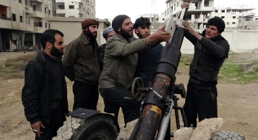Free Syrian Army fighters use an iPad as they prepare to launch a weapon toward the forces of Syria's President Bashar al-Assad in Ain Tarma, in Eastern Ghouta, a suburb of Damascus January 3, 2015.