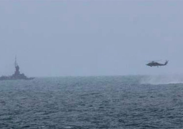 Lt. Col. Jhonson Simatupang of the Indonesian Air Force said Indonesian rescuers have sent a Super Puma helicopter to inspect an area where the Russian team assisting in the search for the AirAsia QZ8501 wreckage has found suspicious objects.