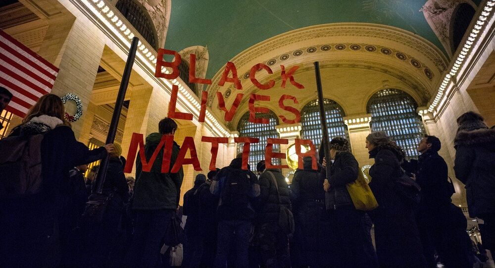 A group of protesters gather at Grand Central Terminal in New York