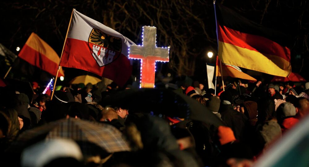 Participants take part in a demonstration called by anti-immigration group PEGIDA