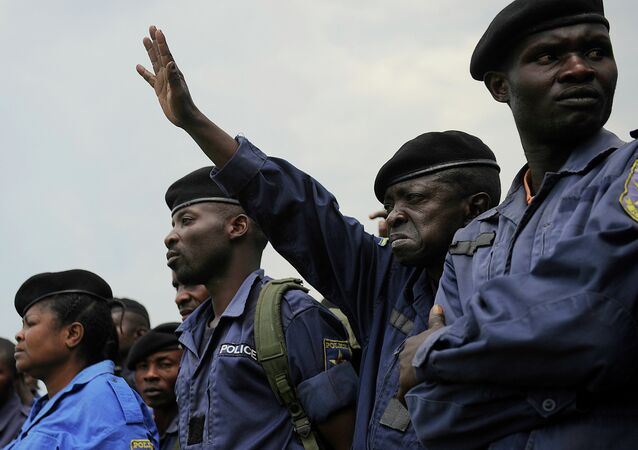 DR Congo police officers participate in a registration excercise on November 22, 2012 carried out by rebel group M23 at the Goma stadium.