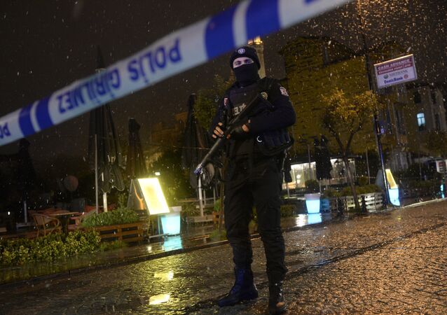 A police officer stands guard along a street after a female suicide bomber was killed on January 6, 2015