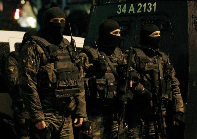 Special forces police officers stand guard at the scene of a bomb blast in Istanbul