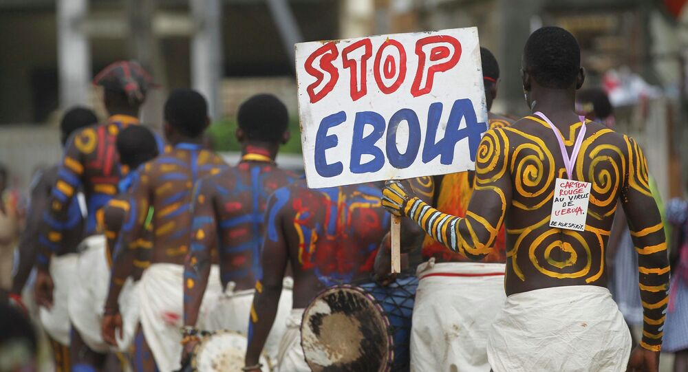 Actors parade on a street after performing at Anono school, during an awareness campaign against Ebola in Abidjan September 25, 2014
