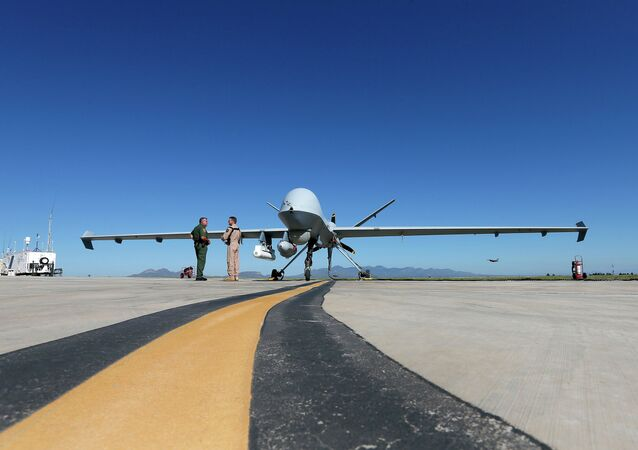 Lothar Eckardt, right, executive director of National Air Security Operations at U.S. Customs and Border Protection, speaks with a Customs and Border Patrol agent prior to a drone aircraft flight, Wednesday, Sept 24, 2014 at Ft. Huachuca in Sierra Vista, Ariz.