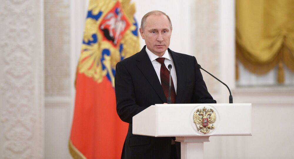 Vladimir Putin at ceremonial reception marking Heroes of the Fatherland Day. Archive photo