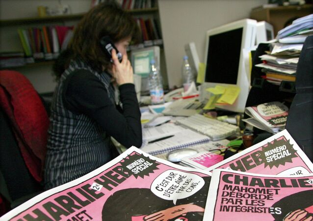 A journalist works in the Paris newsroom of French satirical weekly Charlie Hebdo