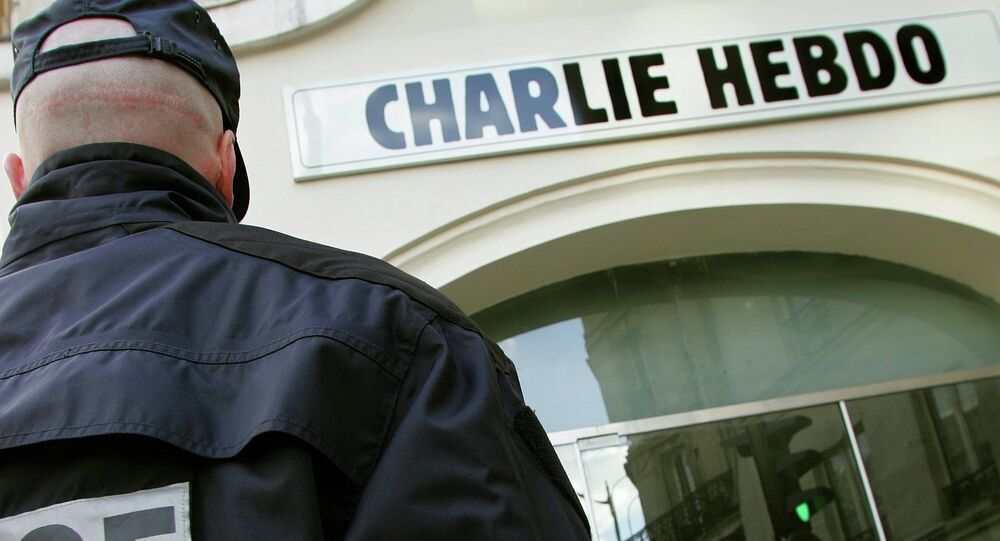 A policeman stands guard outside the French satirical weekly Charlie Hebdo in Paris