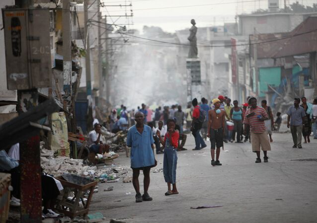Displaced Haitians whose homes were damage during the earthquake gather in a street of Port-au-Prince, Friday, Jan. 15, 2010.