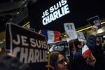 People hold posters with the words Je Suis Charlie (I Am Charlie) outside the Newseum January 7, 2015 in Washington, DC