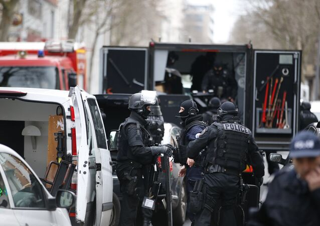 Members of the French national police intervention group (BRI) arrive at the scene where a female police officer was shot dead in Montrouge