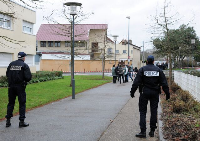 Police stand guard as members of the French technical and scientific police work at the site near a mosque in the Sablons neighborhood of Le Mans