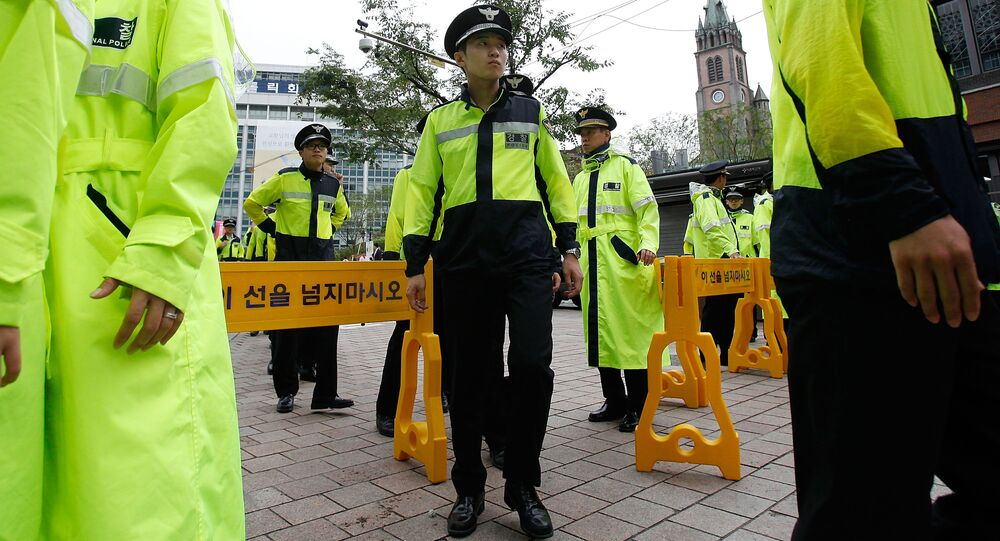 South Korean police stand guard outside of Myeong-dong Cathedral