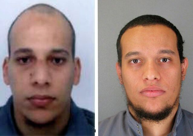 This photo provided by The Paris Police Prefecture Thursday, Jan.8, 2015 shows the suspects Cherif, left, and Said Kouachi in the newspaper attack along with a plea for witnesses