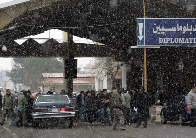 People cross from Lebanon into Syria and visa versa during a snow storm