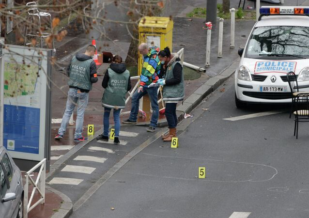 Police forensics experts examine the scene where a female police officer was shot dead in Montrouge, a southern suburb of Paris on January 8, 2015