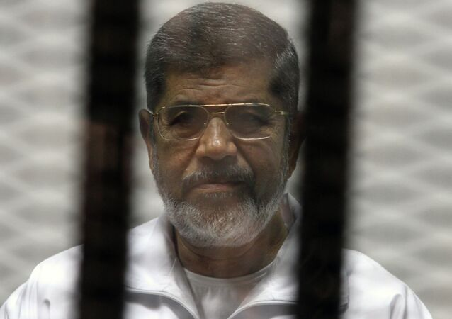 Egyptian ousted Islamist president Mohamed Morsi looks on from behind the defendants cage during his trial. File photo.