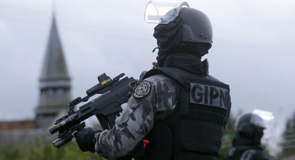 Members of the French GIPN intervention police forces secure a neighbourhood in Corcy, northeast of Paris January 8, 2015. French anti-terrorism police converged on an area northeast of Paris on Thursday after two brothers suspected of being behind an attack on the satirical newspaper Charlie Hebdo were spotted at a petrol station in Villers-Cotterets in the region.